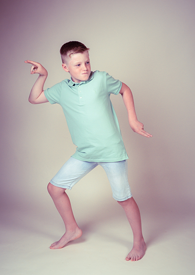 Young boy dancing and striking a pose