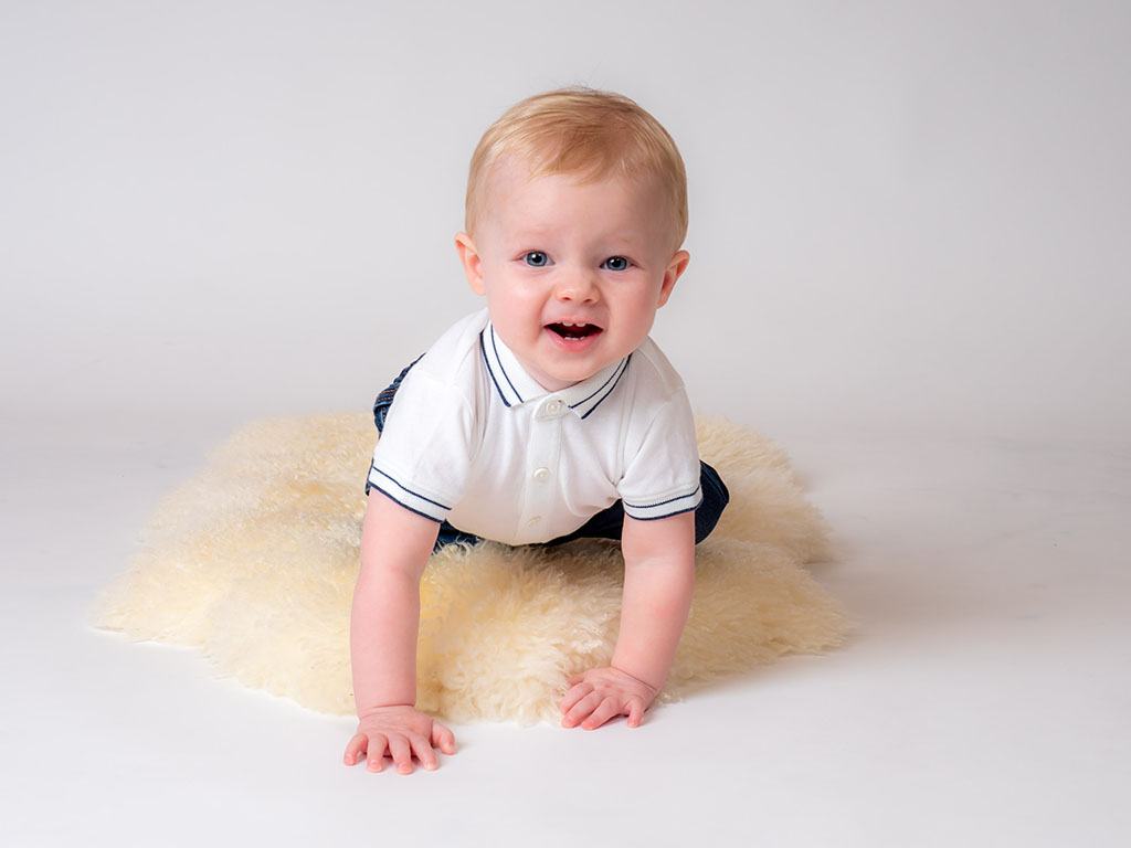 10 month old crawling and having fun taken by qualified baby photographer in Braintree, Essex