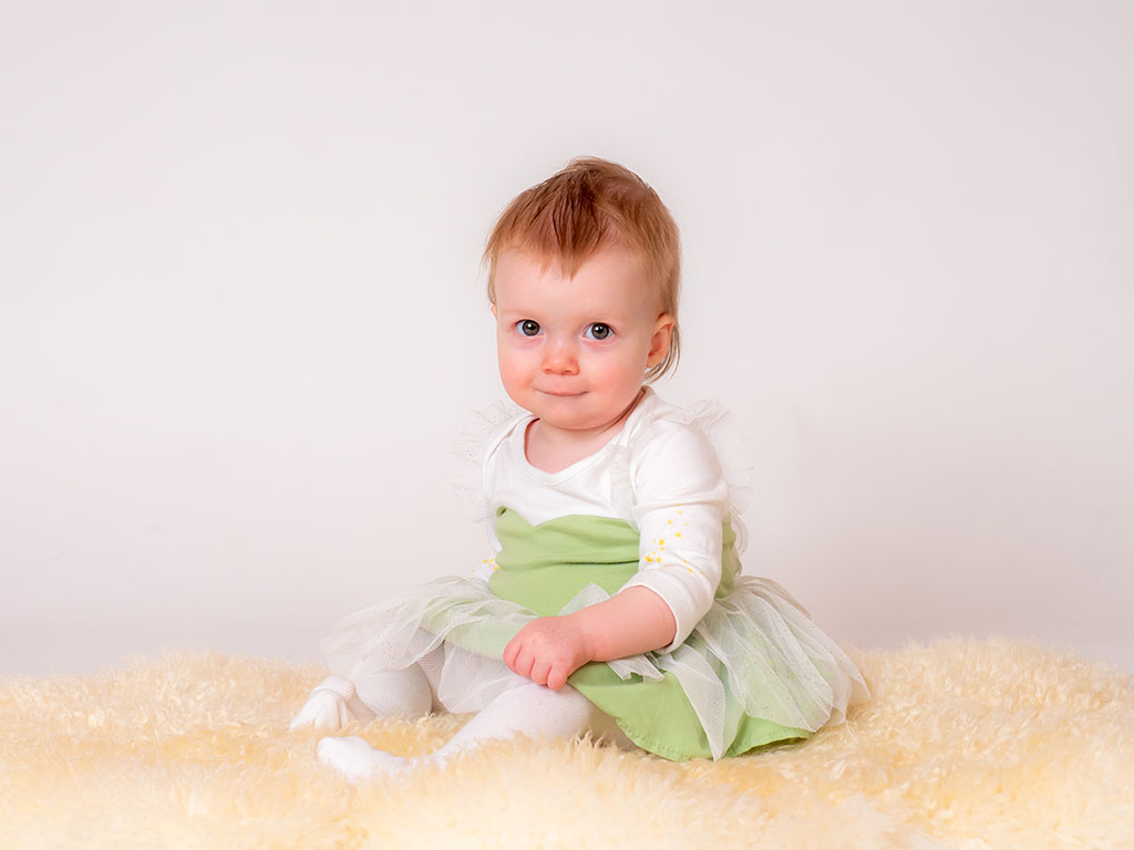 pretty baby girl in fairy outfit for sitting up unaided in studio taken by qualified baby photographer in Braintree, Essex